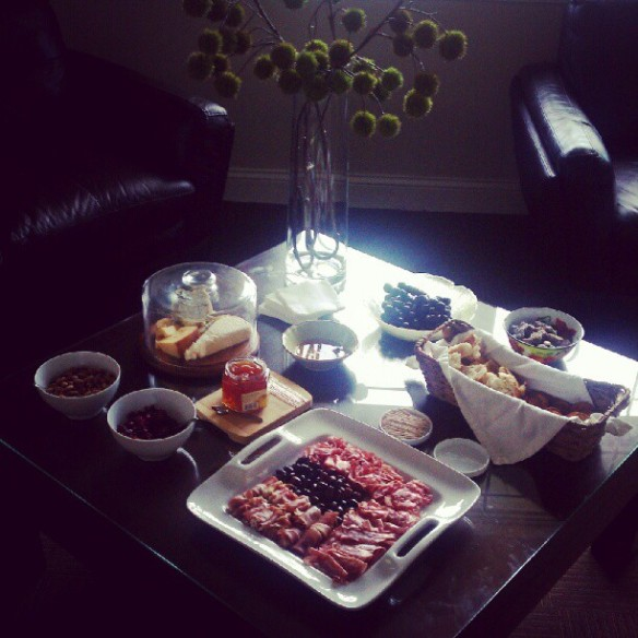 Antipasto: Gourmet meats and cheeses, olives, black grapes, raw almonds, dates, dried cranberries, honey and quince jam.