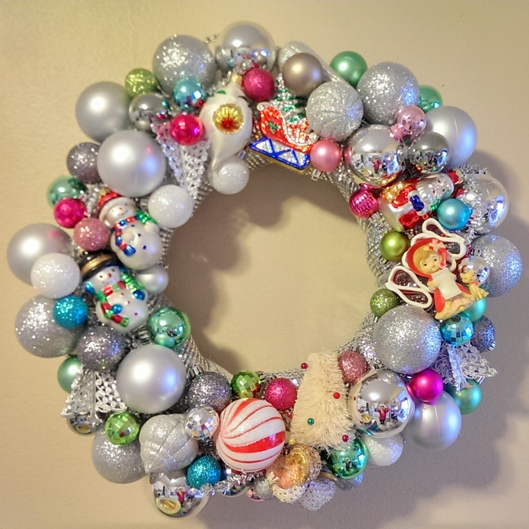 My wreath from the crafting party - a mix of some of my mom's vintage ornaments and cheapos from Target! I've sold almost a dozen since attending this party!