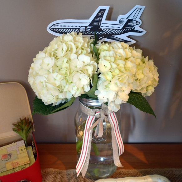 Love is a Journey Bridal Shower by Pastiche Events | Airplane and Hydrangea Centerpieces